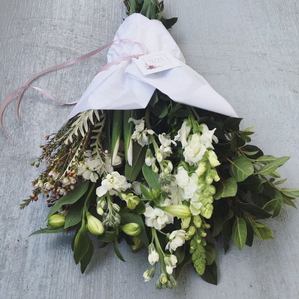 Today's bunch is bursting with white flowers about to bloom! White irises, snaps, sprays, alstromerias, wax and viburnum will brighten up this windy friday ? Order online at www.petalandpost.co.za